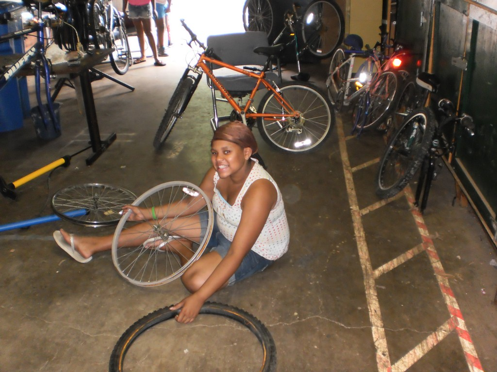 Changing a tire at the Fraim Boys & Girls Club Build-a-Bike sponsored by the Mike Clark Foundation