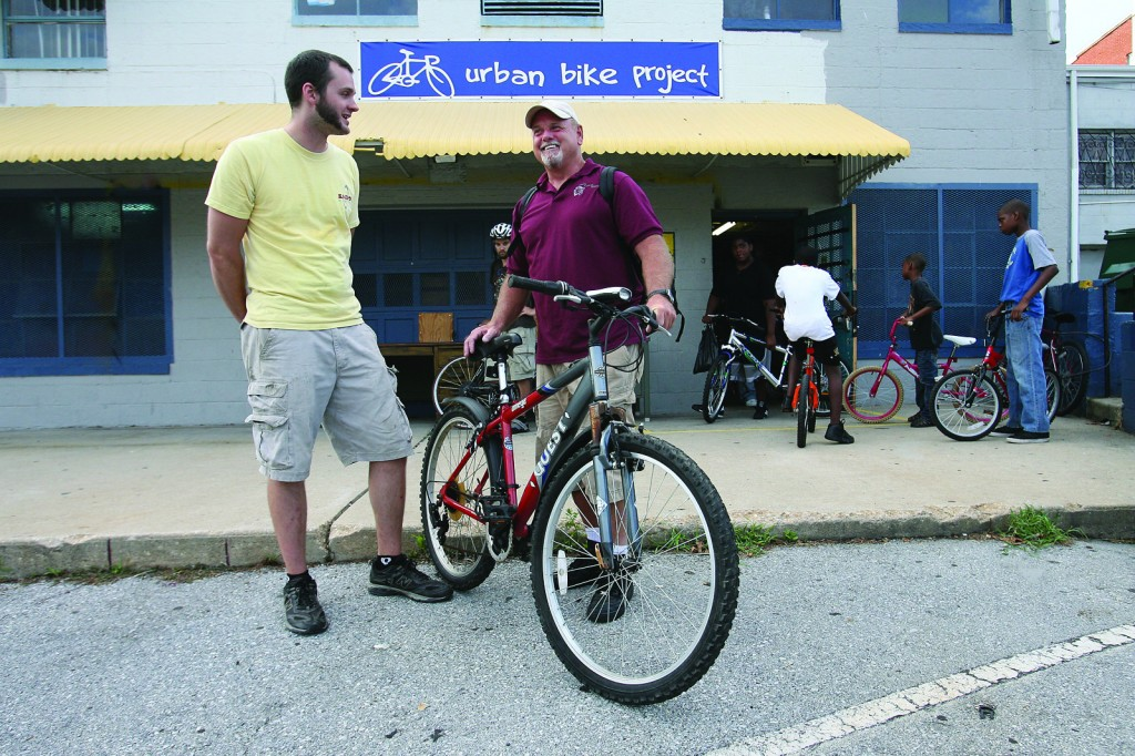 Brian talks with a Free Bike recipient outside of Open Shop