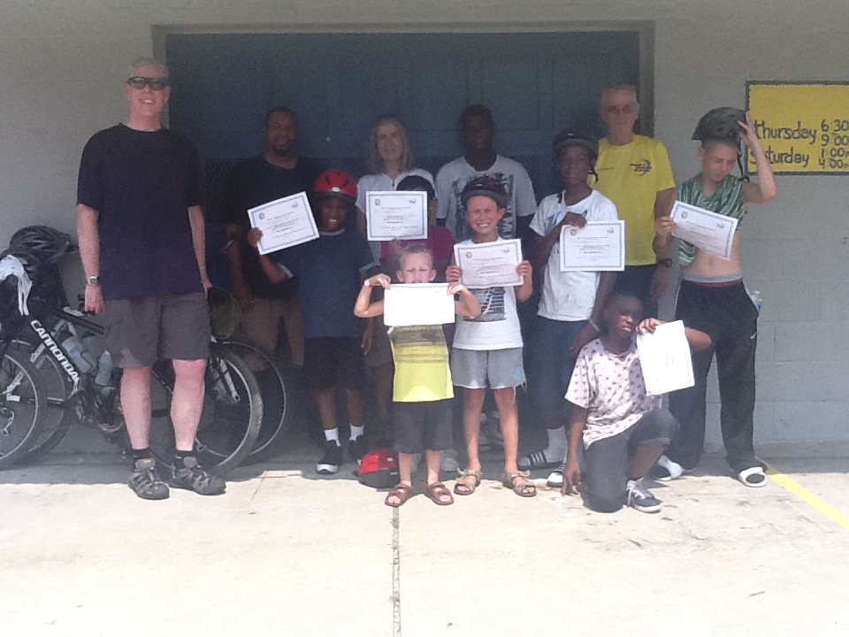 Corry with the final class of Earn-A-Bike, a Youth Bicycling Safety & Skills class.